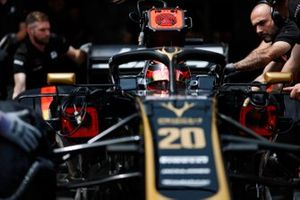 Kevin Magnussen, Haas F1 Team VF-19, is attended to by mechanics