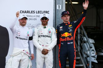 Lewis Hamilton, Mercedes AMG F1, celebrates pole position, alongside Valtteri Bottas, Mercedes AMG F1, and Max Verstappen, Red Bull Racing