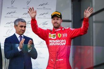 Sebastian Vettel, Ferrari, 3rd position, arrives on the podium