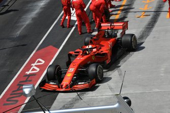 Sebastian Vettel, Ferrari SF90, leaves his pit box after a stop