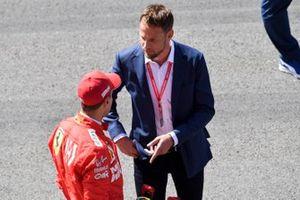 Sebastian Vettel, Ferrari, talks to Jenson Button, Sky Sports F1, after Qualifying