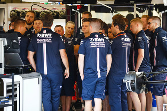 Force India mechanics and team members gather in a huddle on Thursday morning