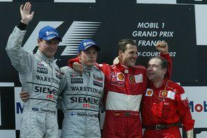 Podium: 1. Michael Schumacher, 2. Kimi Räikkönen, McLaren, 3. David Coulthard