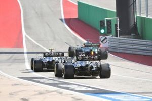 Lance Stroll, Aston Martin AMR21, Valtteri Bottas, Mercedes W12, and Lewis Hamilton, Mercedes W12
