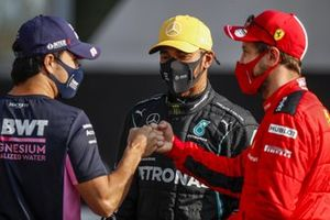 Sergio Perez, Racing Point, and Sebastian Vettel, Ferrari, bump fists as Lewis Hamilton, Mercedes-AMG F1, looks on