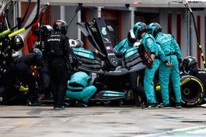 Lewis Hamilton, Mercedes W12, changes his front wing in the pits