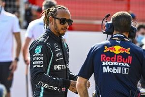 Lewis Hamilton, Mercedes, speaks with a Red Bull Racing engineer
