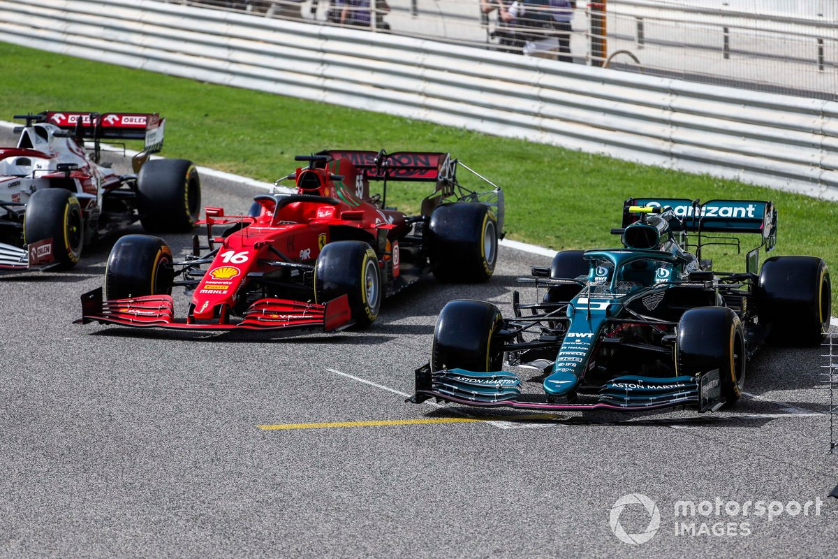The cars of Charles Leclerc, Ferrari SF21, and Sebastian Vettel, Aston Martin AMR21