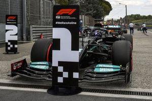 Lewis Hamilton, Mercedes W12, arrives in Parc Ferme after securing pole