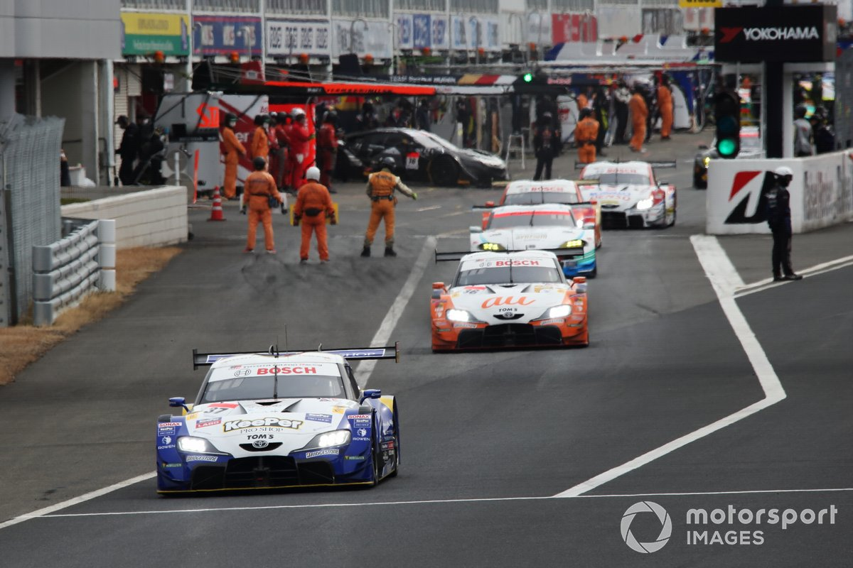 Cars leave the pitlane