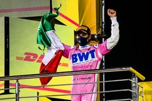 Sergio Perez, Racing Point, 1st position, on the podium with a Mexican flag