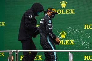 Toto Wolff, Executive Director (Business), Mercedes AMG, Lewis Hamilton, Mercedes-AMG F1, 1st position, and Sebastian Vettel, Ferrari, 3rd position, celebrate on the podium