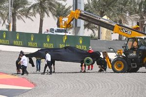 The car of Lewis Hamilton, Mercedes W12, is recovered following a spin