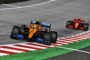 Lando Norris, McLaren MCL35, leads Charles Leclerc, Ferrari SF1000