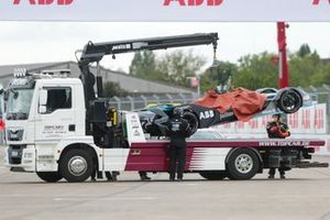 Formula E car lifted onto a flat bed lorry