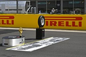 The trophy and a tyre from the first race on the grid prior to the start