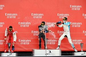 Mick Schumacher, Prema Racing, Race Winner Yuki Tsunoda, Carlin and Jack Aitken, Campos Racing celebrate on the podium with the champagne