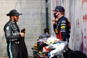 Lewis Hamilton, Mercedes AMG F1, 2nd position, talks with Max Verstappen, Red Bull Racing, 1st position, after the race