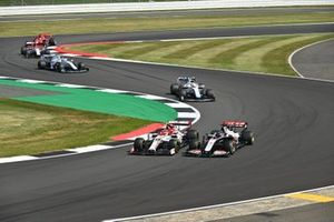 Romain Grosjean, Haas VF-20, battles with Antonio Giovinazzi, Alfa Romeo Racing C39, ahead of George Russell, Williams FW43, Nicholas Latifi, Williams FW43, Kimi Raikkonen, Alfa Romeo Racing C39, and Sebastian Vettel, Ferrari SF1000