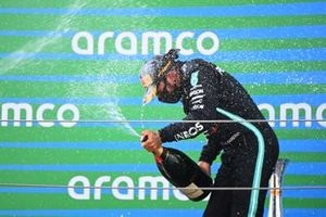 Lewis Hamilton, Mercedes-AMG Petronas F1, 1st position, celebrates on the podium with Champagne