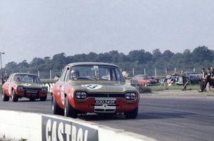 Frank Gardner, Ford Escort, leads Peter Arundell, Ford Escort