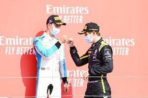 Jack Aitken, Campos Racing, and Christian Lundgaard, ART Grand Prix, celebrate on the podium