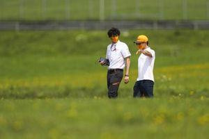 Lando Norris, McLaren walk the track