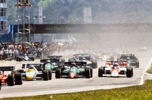 Keke Rosberg, Williams FW09 Honda, battles with Eddie Cheever, Alfa Romeo 184T, and Alain Prost, McLaren MP4-2 TAG, at the start