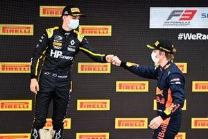 Race winner Liam Lawson, Hitech Grand Prix celebrates on the podium with Oscar Piastri, Prema Racing