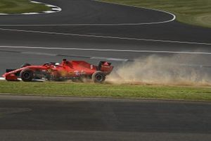 Sebastian Vettel, Ferrari SF1000, kicks up dust and sparks