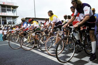 The drivers line up for a bicycle race around the Interlagos circuit, Ronnie Peterson, Niki Lauda, Ferrari and James Hunt, McLaren