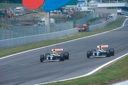 Alain Prost passes Damon Hill, both Williams FW15C Renault's, for the lead