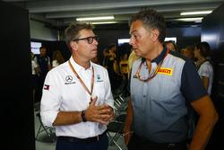 Mario Isola, Racing Manager, Pirelli Motorsport, talks to an AMG Mercedes team member