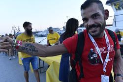 Fan with tattoo