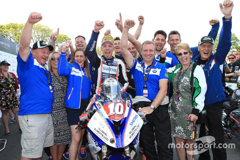 Peter Hickman celebrates with his team after winning the RL360º Superstock TT race