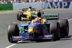 Johnny Herbert, Sauber, leads Damon Hill, Jordan