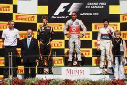 Podium: race winner Lewis Hamilton, McLaren, second place Romain Grosjean Lotus F1, third place Sergio Perez, Sauber