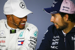 Lewis Hamilton, Mercedes AMG F1, 1st position, and Sergio Perez, Force India, 3rd position, share a joke in the Press Conference