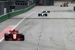 Sebastian Vettel, Ferrari SF71H, leads Lewis Hamilton, Mercedes AMG F1 W09, and Valtteri Bottas, Mercedes AMG F1 W09