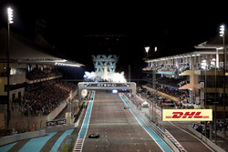 Valtteri Bottas, Mercedes-Benz F1 W08  crosses the line to take the chequered flag and win the race with Lewis Hamilton, Mercedes-Benz F1 W08  following to take second place and celebrate with the team on pitwall