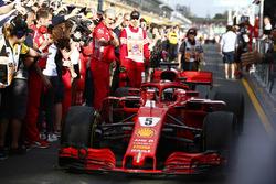 Sebastian Vettel, Ferrari SF71H, 1st position, passes Maurizio Arrivabene, Team Principal, Ferrari, as he brings his car in to Parc Ferme