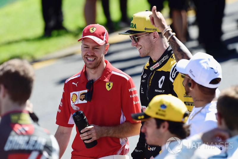 Sebastian Vettel, Ferrari and Nico Hulkenberg, Renault Sport F1 Team