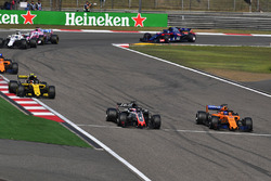 Romain Grosjean, Haas F1 Team VF-18 and Fernando Alonso, McLaren MCL33 battle