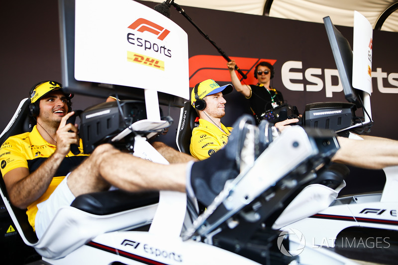 Carlos Sainz Jr., Renault Sport F1 Team, and Nico Hulkenberg, Renault Sport F1 Team, try out the F1 eSports