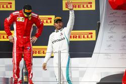Kimi Raikkonen, Ferrari, 3rd position, Lewis Hamilton, Mercedes AMG F1, 1st position, on the podium