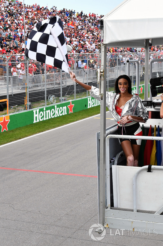 Winnnie Harlow, waves the chequered flag