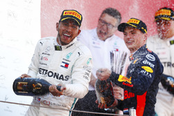 Lewis Hamilton, Mercedes AMG F1, Max Verstappen, Red Bull Racing celebrate on the podium by spraying champagne