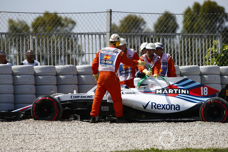 Lance Stroll, Williams FW41, is assisted by marshals after driving into the gravel in FP1
