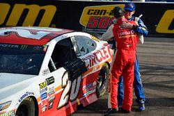 Matt Kenseth, Joe Gibbs Racing Toyota celebrates with Kyle Busch, Joe Gibbs Racing Toyota after winn