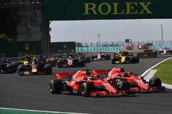 Sebastian Vettel, Ferrari SF71H and Kimi Raikkonen, Ferrari SF71H battle at the start of the race